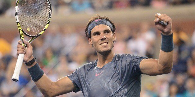 Spanish tennis player Rafael Nadal celebrates victory over Germany's Philipp Kohlschreiber during their 2013 US Open men's si