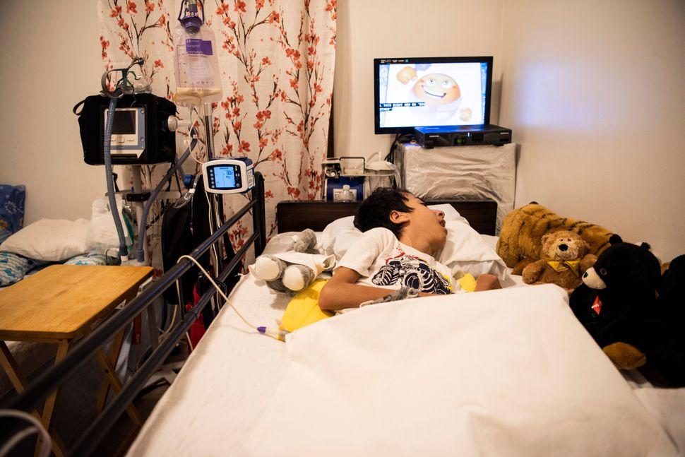 Noori's son Ahmad, 14, has spinabifida and needs 24-hour care.
