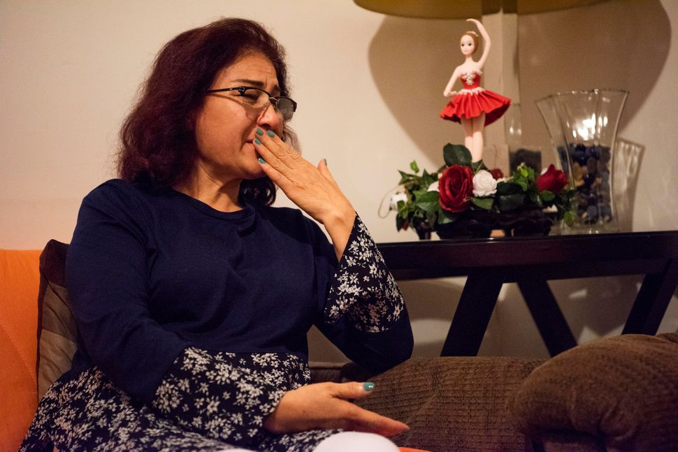"""""""We are a family. We need to be together,"""" says Zarmina Noori, whose husband is on the other side of the world."""