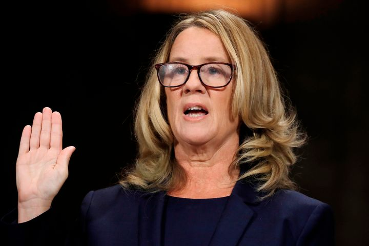 Christine Blasey Ford being sworn in to testify before the Senate Judiciary Committee about her sexual assault allegation aga