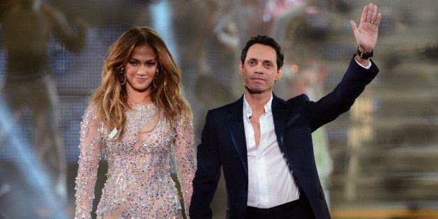 LAS VEGAS, NV - MAY 26:  Singer/actress Jennifer Lopez (L) and singer Marc Anthony appear during the finale of the Q'Viva! Th