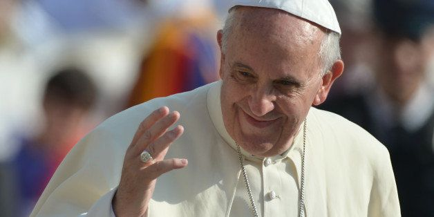 Pope Francis greets the crowd during his general audience at St Peter's square on October 30, 2013 at the Vatican.  AFP PHOTO
