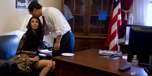 UNITED STATES - JANUARY 03:  Freshman Rep. Joaquin Castro, D-Texas, hangs out in his Cannon Building office with his girlfrie