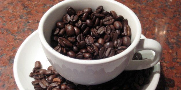 Coffee beans in a cup; taken by me :)