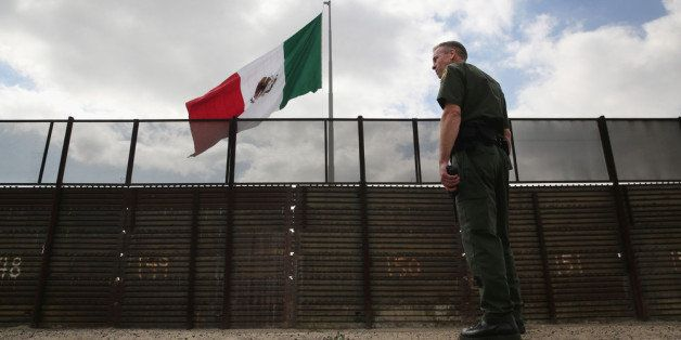 SAN YSIDRO, CA - OCTOBER 03:  U.S. Border Patrol agent Jerry Conlin stands on the American side of the U.S.-Mexico border fen
