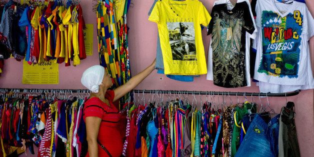A client looks for clothes in a privately-owned shop in Havana, on October 4, 2013. Cuban Labor Vice Minister Marta Elena Fei