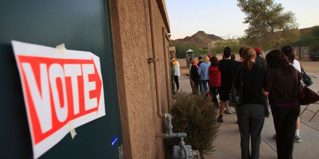 PHOENIX - NOVEMBER 4:  Voters stand in line at their polling place at St. Stephen's Byzantine Catholic Church before dawn in