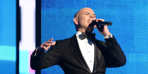 LOS ANGELES, CA - NOVEMBER 24:  Host Pitbull speaks onstage during the 2013 American Music Awards at Nokia Theatre L.A. Live
