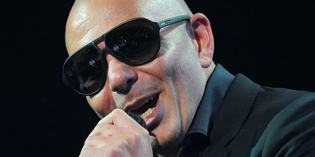 SAN JOSE, CA - DECEMBER 03: Pitbull performs at the 99.7 (NOW!) Triple Ho Show 4.0 at SAP Center on December 3, 2013 in San J