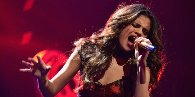 BOSTON, MA - DECEMBER 14:  Selena Gomez performs onstage during KISS 108's Jingle Ball 2013, at TD Garden on December 14, 201