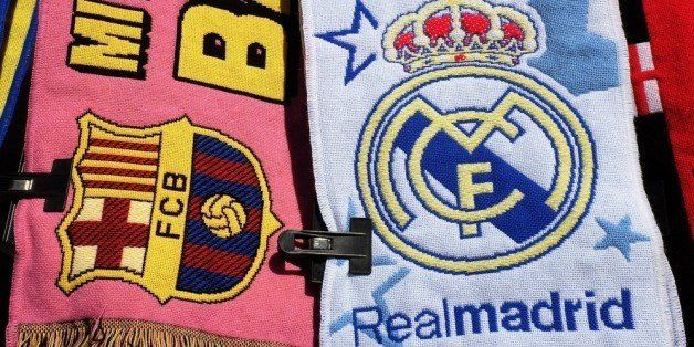 MADRID, SPAIN - DECEMBER 21:  Football scarves displaying the emblems of FC Barcelona and Real Madrid are sold on a stall on