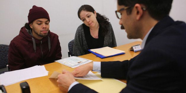 NEW YORK, NY - JANUARY 31:  Immigration lawyer Andres Lemons advises Angel and Evie Gomez on their U.S. citizenship applicati