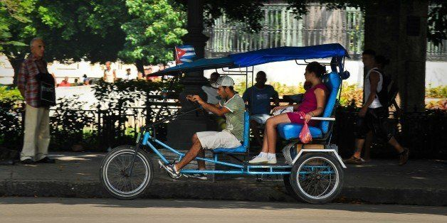A pedicab carries passengers along a street of Havana, on February 10, 2012.  The 50-year-long U.S. embargo to Cuba subjected