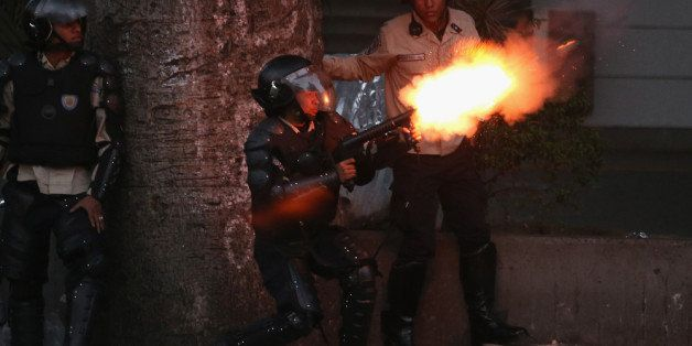 CARACAS, VENEZUELA - MARCH 06:  Venezuelan national police fire tear gas at anti-government protesters on March 6, 2014 in Ca