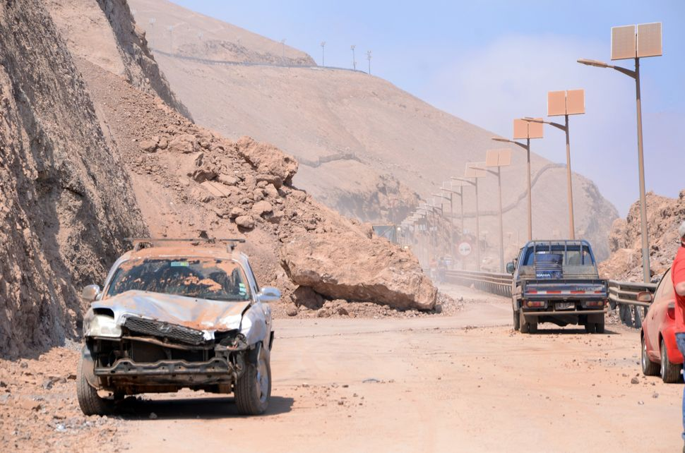 Damaged cars in Iquique, northern Chile, on April 2, 2014 a day after a powerful 8.2-magnitude earthquake hit off Chile's Pac