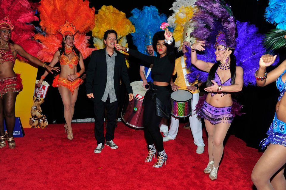 ATLANTA, GA - APRIL 07: (L-R) Rio 2 Director Carlos Saldanha and recording artist Janelle Monae attend 'RIO 2' Red Carpet Scr