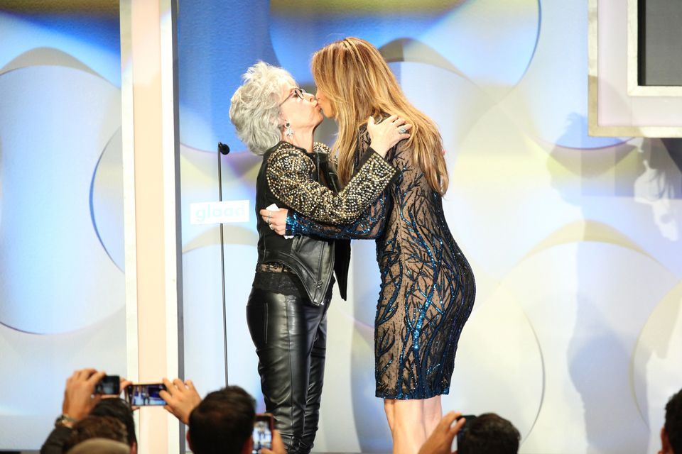 BEVERLY HILLS, CA - APRIL 12:  Actress Rita Moreno (L) and recording artist Jennifer Lopez speak onstage at the 25th Annual G