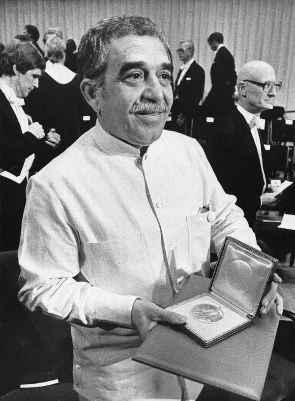 Gabriel Garcia Marquez, winner of the Nobel Prize for Literature, shows his award to the audience, following the ceremony in