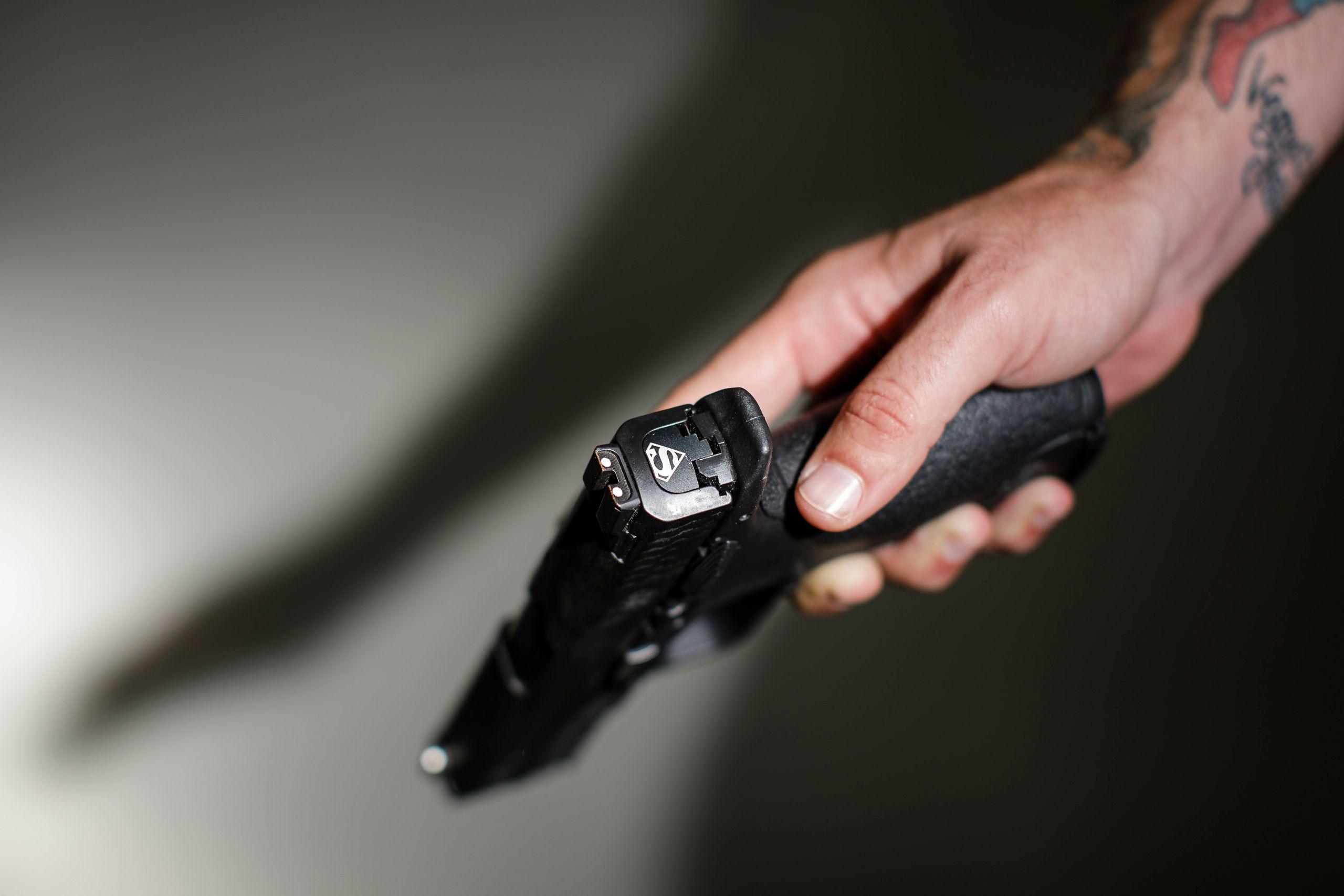 Hooper's .40 caliber handgun has a custom Superman logo.
