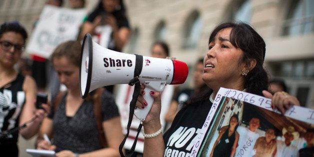 WASHINGTON, DC - MAY 9, 2014: Bertha Avila of El Salvador speaks to protesters in front of the U.S. Customs and Border Protec