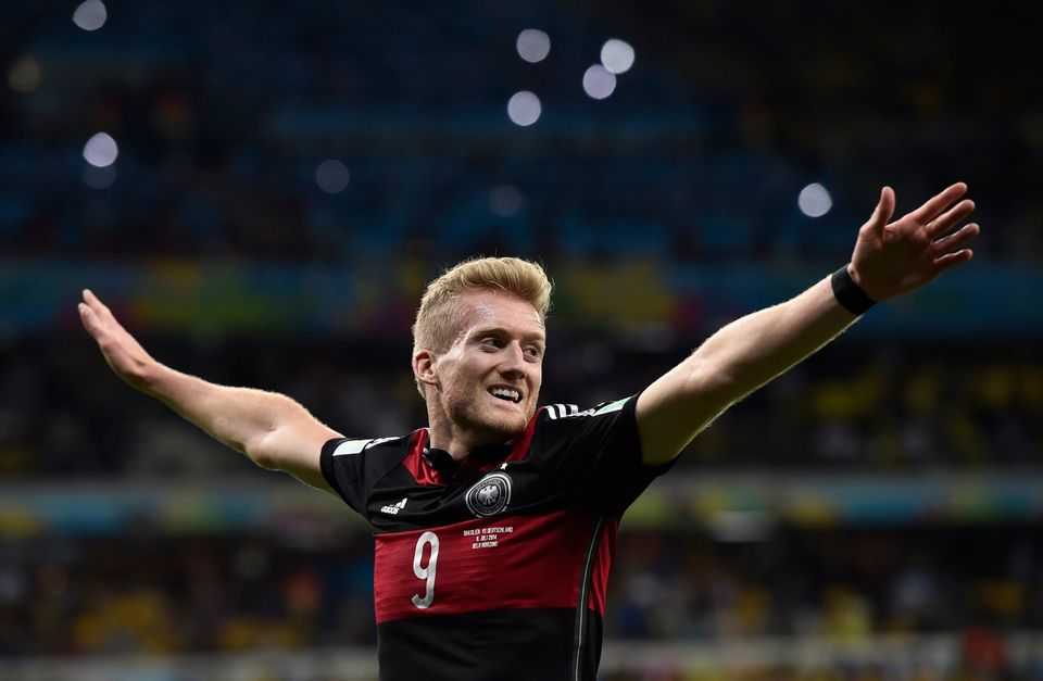 Germany's Andre Schuerrle celebrates after scoring his side's seventh goal during the World Cup semifinal soccer match betwee