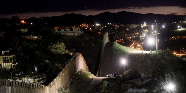 NOGALES, AZ - JULY 6:  The border wall is illuminated at night July 6, 2012 in Nogales, Arizona. The president-elect of Mexic