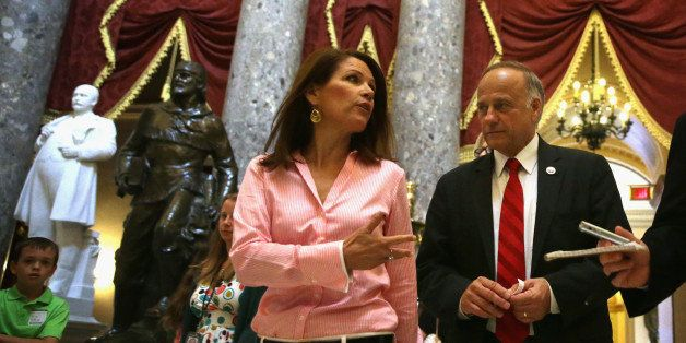 WASHINGTON, DC - AUGUST 01:  U.S. Rep. Steve King (R-IA) (R) and Rep. Michele Bachmann (R-MN) (2nd R) pass through the Statua