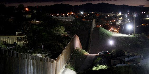 NOGALES, AZ - JULY 6:  The border wall is illuminated at night July 6, 2012 in Nogales, Arizona. The president-elect of Mexic