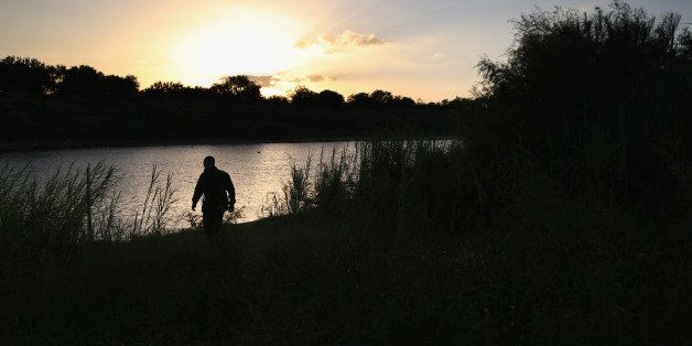 MCALLEN, TX - SEPTEMBER 08:  A U.S. Border Patrol agent inspects the bank of the Rio Grande River across from Mexico on Septe