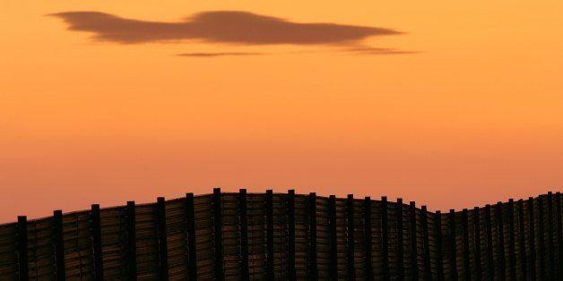 CAMPO, CA - OCTOBER 08:  Dusk falls over a section of the US-Mexico border fence which activists opposing illegal immigration
