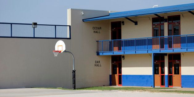 A basketball goal is seen in the courtyard at the Karnes County Residential Center, Thursday, July 31, 2014, in Karnes City,
