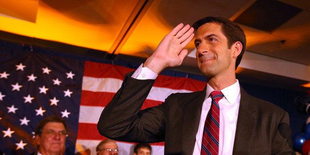 NORTH LITTLE ROCK, AR - NOVEMBER 04: U.S. Rep. Tom Cotton (R-AR) and republican U.S. Senate elect in Arkansas salutes supporters during an election night gathering on November 4, 2014 in Little Rock, Arkansas. Cotton defeated two-term incumbent democrat U.S. Sen. Mark Pryor (D-AR). (Photo by Justin Sullivan/Getty Images)