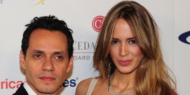 Singer Marc Anthony and model Shannon de Lima pose on arrival for the 27th annual Sports Spectacular in Los Angeles on May 20