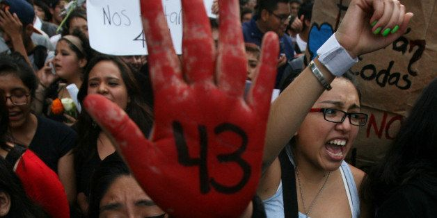 In this Oct. 22, 2014 photo, pepole protest the disappearance of 43 students in Mexico City. On Sept. 26, students from the R