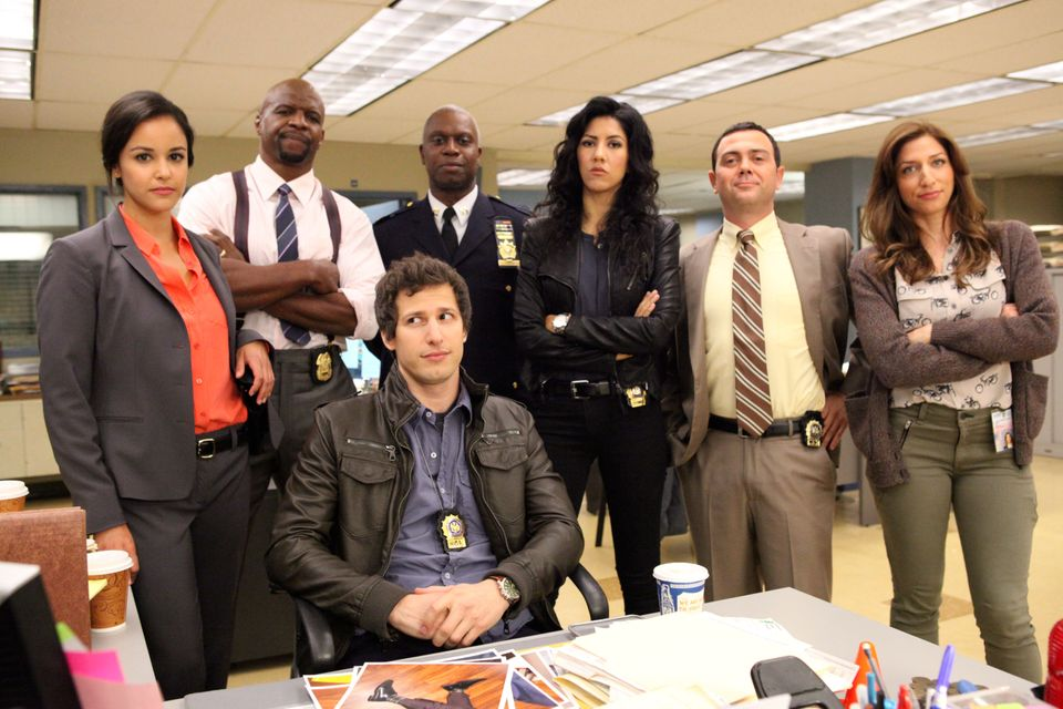 BROOKLYN NINE-NINE -- Pilot -- Pictured: (l-r) Melissa Fumero as Amy, Terry Crews as Terry, Andy Samberg as Jake, Andre Braug