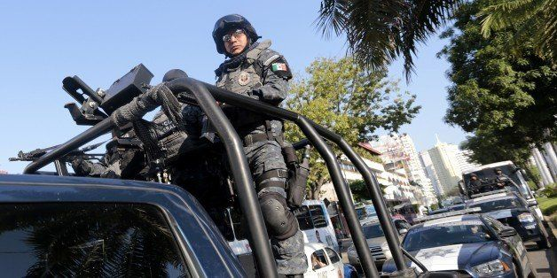 Mexican federal policemen patrol a street in Acapulco, Guerrero state, Mexico on December 3, 2014. Mexican federal forces arr