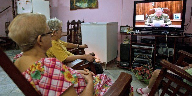 Cubans watch Cuban president Raul Castro on TV while he addresses the country, on December 17, 2014 in Havana. Castro said th