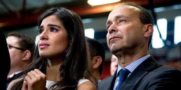 Actress Diane Guerrero and Rep. Luis Gutierrez, D-Ill., listens as President Barack Obama speaks about immigration at Del Sol