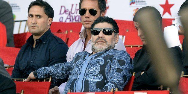 Argentiniean former football player Diego Maradona attends the commemoration of the 190 years of the Battle of Ayacucho and grade promotion ceremony of the Bolivarian National Armed Forces at the National Pantheon in Caracas, on December 9, 2014. AFP PHOTO/FEDERICO PARRA (Photo credit should read FEDERICO PARRA/AFP/Getty Images)