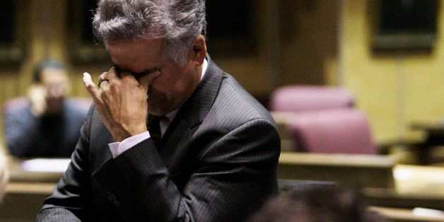 Arizona state Sen. John Huppenthal, R-District 20, pauses during a special session in the Arizona Senate at the state capitol