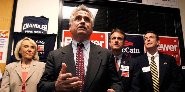 In this Aug. 26, 2010 photo, Republican candidate for state superintendent of public instruction John Huppenthal, front, talk