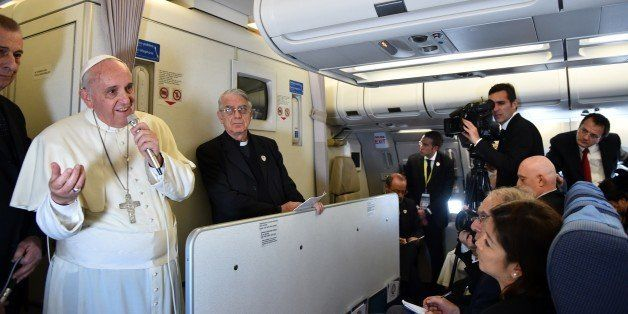 Pope Francis addresses journalist sitting onboard a plane during his trip back to Rome, on January 19, 2015 from the Philippi