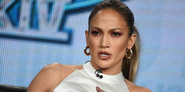 "Jennifer Lopez speaks on stage during the ""American Idol"" panel at the Fox 2015 Winter TCA on Saturday, Jan. 17, 2015, in Pas"