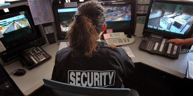FLORENCE, AZ - JULY 30:  A guard monitors surveillance cameras inside the U.S. Immigration and Customs Enforcement (ICE) dete