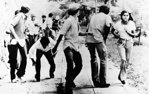 <em>Anti-government demonstrators run for cover Monday, October 22, 1979, in San Salvador as gunmen open fire from a hilltop
