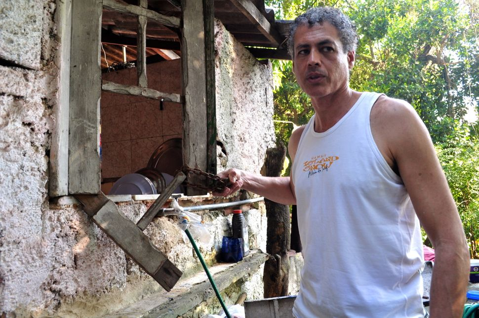 In 1986, police occupied the property and forced the community to stop its monthly samba parties. José Claudio holds the rust
