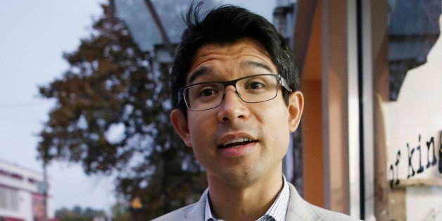 Democratic City Council candidate Carlos Menchaca discusses why he's running for office, Wednesday, Oct. 16, 2013, in the Sun