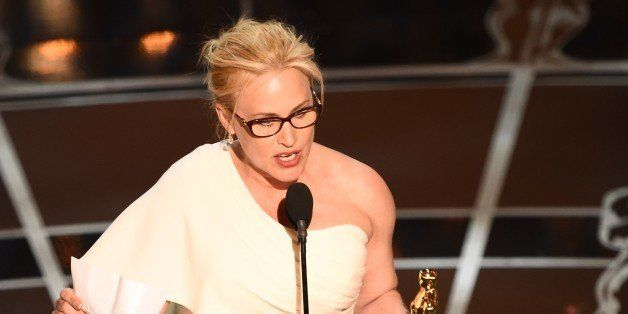 Winner for Best Supporting Actress Patricia Arquette accepts her award on stage at the 87th Oscars February 22, 2015 in Holly