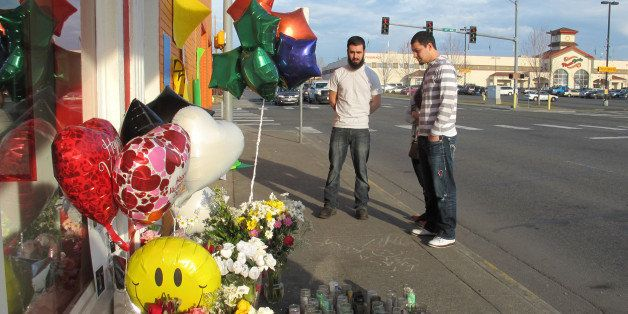 In this Feb. 18, 2015 photo, pedestrians view a memorial in Pasco, Wash., on the sidewalk where Antonio Zambrano-Montes, an u