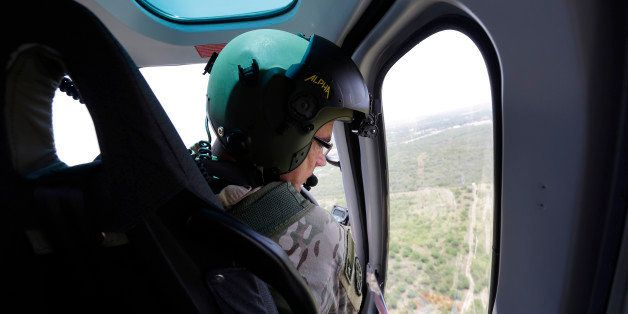 Texas Department of Public Safety Capt. Stacy Holland flies a helicopter to patrol along the Rio Grande, Thursday, July 24, 2